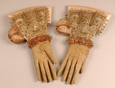 Man's leather ceremonial gloves with silk gauntlet cuffs, early 17th C. The cuffs are embroidered with gold metal thread and seed pearls.