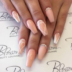 Nude And White Embellished Nails
