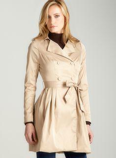 Sleek beige rain coat= FASHION! :)