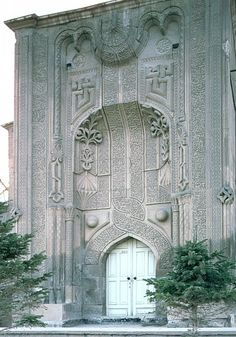 Image TUR 0424 featuring facade from the Ince Minare Medrese, in Konya, Turkey, showing Geometric PatternFloriated Arabesque and Calligraphy using carved masonry or stone relief.