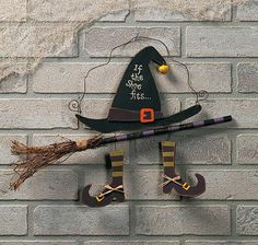 "18""x13""This painted wooden sign with an attached broom of real twigs will charm all your Halloween guests. Decorate your door or add to your other Halloween decorations with this painted wood witch ""If the Shoe Fits"" sign."