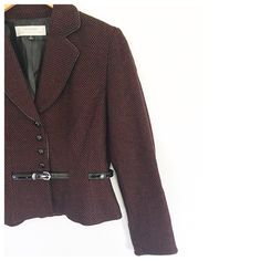 *Belted jacket by Tahari Arthur S. Levine in a black and red overall dot pattern. Front button closure, attached belt and button detail at cuffs. Perfect colors for the holidays! 51% wool, 49% viscose.
