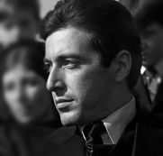 Al Pacino as Michael Corleone in the first Godfather movie. Didn't we all fall in love with him then?