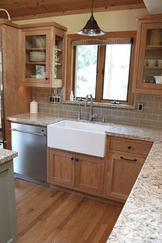 Craftsman Kitchen with High ceiling, Pendant light, Simple granite counters, Inset cabinets, Farmhouse sink, L-shaped