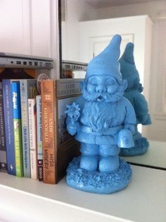 Spray paint a garden gnome for decor - white, gray, and green lil guys