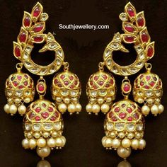 Gorgeous Temple jewellery earrings with a traditional peacock motif. See more on Wedding Vows. Gold Jhumka Earrings, Jewelry Design Earrings, Gold Earrings Designs, Antique Earrings, Antique Jewellery, Mughal Jewelry, Diamond Earrings, Gold Designs, Big Earrings