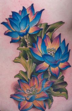This is my first tattoo, 3 lotus flowers located on my lower right back. It took 6 hours to complete in one sitting on 12/3/10. The artist is John Fitzgerald at Slave to the Needle in Ballard, Seattle, Washington.