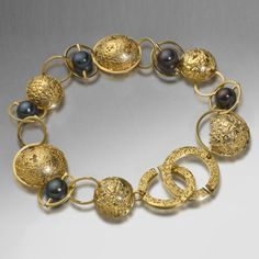 Susi Hines: 18ct etched semisphere bracelet with black pearls  Photo: Simon B Armitt