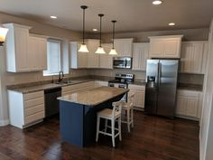 Kitchen refinished by Chameleon Painting SLC, UT in Sherwin Williams pure white and island in Hale Navy. Walls painted in BM Balboa Mist. Decor, Furniture, Refinishing Cabinets, Kitchen Refinishing, Kitchen Cabinets, Kitchen Decor, Refinishing Furniture, Home Decor, Kitchen