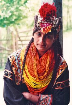 Kalash of Northern Pakistan. The Kalash are fascinating. They don't share DNA markers with any other races/peoples, and they are so isolated they have managed to preserve their culture. Kalash People, World Hair, Pakistani Culture, Body Adornment, World Of Color, Ethnic Fashion, Bridal Make Up, People Around The World, World Cultures