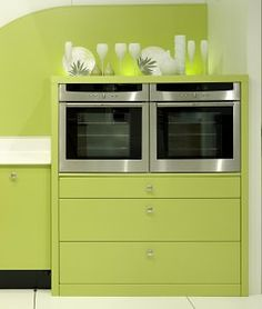 Neff's Single Built In Ovens sitting side by side in a splash of lime.