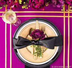 Tie together a place setting with metallic hues, rich black, and pops of bright colors.