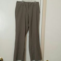 Light Brown Slacks Light brown slacks. Average size 6 from New York & Company. Sit below the waist, with a front zipper, a double hook and two back and front pockets. New York & Company Pants Boot Cut & Flare