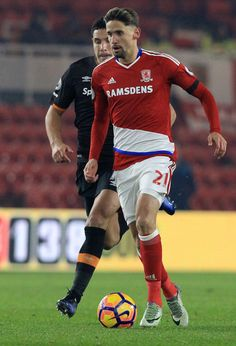 Hull City's English midfielder Jake Livermore (L) vies with Middlesbrough's Uruguayan midfielder Gaston Ramírez during the English Premier League football match between Middlesbrough and Hull City at Riverside Stadium in Middlesbrough, northeast England on December 5, 2016. / AFP / Lindsey PARNABY / RESTRICTED TO EDITORIAL USE. No use with unauthorized audio, video, data, fixture lists, club/league logos or 'live' services. Online in-match use limited to 75 images, no video emulation. No…