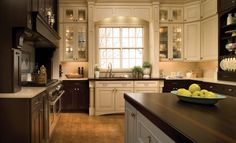 I love dark rich woods in a kitchen but there needs to be a lot of light to balance out the dark cabinetry.