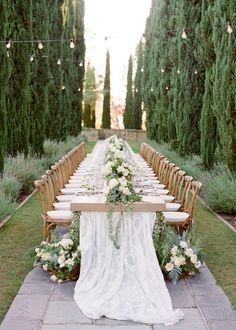 FOR THE RECEPTION || Estate twilight dinner with long tables with festoon fairy lights, lace table runner & crossback chairs || NOVELA BRIDE...where the modern romantics play & plan the most stylish weddings...Join the clique... www.novelabride.com @novelabride