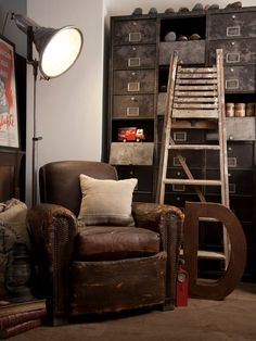 Loving this weathered leather armchair and the vintage industrial style