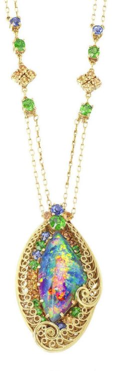Attributed to Louis Comfort Tiffany for Tiffany & Co. - An Arts and Crafts black opal, demantoid and sapphire necklace, circa 1915. Centring a black opal, measuring approximately 4.43 x 11.65 x 5.48mm, within a gold filigree openwork frame, accented throughout by demantoids and sapphires, to a delicate cable link chain; signed Tiffany & Co., numbered; probably designed by Meta Overbeck; mounted in 18k gold; length: 31in.