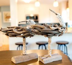 Driftwood shore bird decor living room: http://www.completely-coastal.com/2015/07/blue-coastal-living-room-sea-life-rug-drawer-chest.html