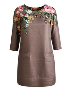 Joules Womens Tunic, Taupe Posy.                     This charming linen tunic is perfect paired with jeans, leggings and (if you're feeling brave and the weather allows) bare legs. The floral print gives it a nostalgic cottage-garden feel.