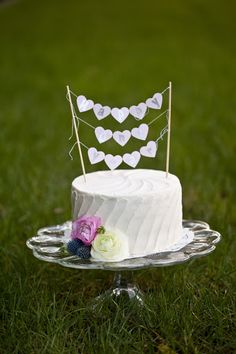 Wedding Anniversary cake with banner topper.  http://mavenbride.com/wedding-anniversary-photo-shoot
