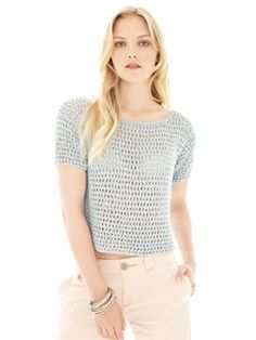 Knit this womens cropped open work top from Rowan Knitting & Crochet Magazine 53, a design by Amanda Crawford using the beautiful yarn Panama (viscose, cotton and linen). With a gorgeous open work stitch pattern, wide round neck and straight cast off short sleeves, this knitting pattern is for the beginner knitter.