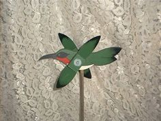 WHIRLIGIG-  HUMMING BIRD