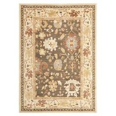 """Loomed rug in brown with a classic floral motif.  Product: RugConstruction Material: PolypropyleneColor: Brown and cremeFeatures:  Power-loomed0.25"""" Pile heightMade in Turkey  Note: Please be aware that actual colors may vary from those shown on your screen. Accent rugs may also not show the entire pattern that the corresponding area rugs have."""