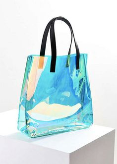 Shop Skinnydip Iridescent Tote Bag at Urban Outfitters today. We carry all the latest styles, colors and brands for you to choose from right here. Vintage Phone Case, Unicorn Outfit, Unicorn Clothes, Clear Tote Bags, Transparent Bag, Cute Purses, Shopper Tote, Fashion Bags, Fashion Handbags