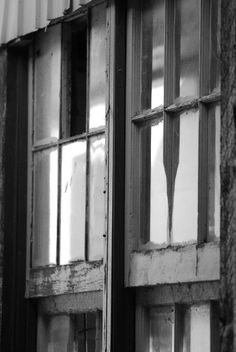Reflections in old barn windows