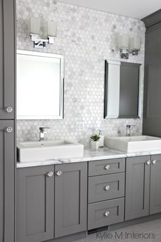 Marble backsplash in hexagon shape with vanity cabinets painted Chelsea Gray, double sinks and chrome accents by Kylie M Interiors.  Countertop is Calacatta Marble by Formica 180fx #formicabrandlove #formica #marble #kylieminteriors