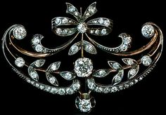 An Elegant Belle Epoque Diamond Brooch Pin. Made in Moscow between 1908 and 1917 and was designed in garland style of the 1910s.