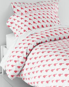 A bright and delightful Garnet Hill tradition season after season, our colorful percale bedding in exuberant prints is re-created from original hand-painted artwork. Each motif makes a statement, printed on a white ground of soft long-staple cotton.