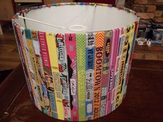 Festival wristband lampshade. Made with a lampshade kit, instead of sticking the backing to a fabric, stick the wristbands onto the backing. Wristbands provided by wristband designer husband :)