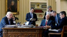 They were all in the Oval Office together back in January: President Donald Trump, Vice President Mike Pence and national security adviser Michael Flynn (far right). (Jonathan Ernst / Reuters)
