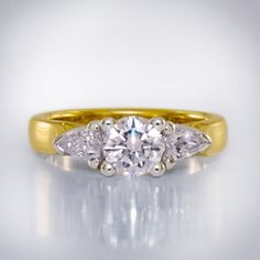 Lucida Style Yellow Gold Shank with Platinum Setting Three-stone Brilliant Centre and Pear Diamond Sides