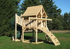 Triumph Play System's Bailey wooden swing set with tire swing and super large play deck. Playset Diy, Backyard Playset, Wooden Playset, Cedar Swing Sets, Swing Set Plans, Backyard Ideas For Small Yards, Backyard For Kids, Kids Yard, Play Yard