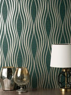 This beautiful Quartz Wave Wallpaper will add a stylish finishing touch to most rooms of your home. The design features an elegant curved pattern of wavy lines with a metallic gold finish and glitter detailing. This is set on a matte paper in a rich emerald green tone that is infused with glitter particles and has a textured fabric effect finish. This high quality vinyl wallpaper could be used to create a feature wall or to decorate an entire room. Waves Wallpaper, Vinyl Wallpaper, Crushed Velvet Wallpaper, Emerald Green, Green And Gold, Metallic Wallpaper, Wave Design, Metallic Gold, Designer Wallpaper