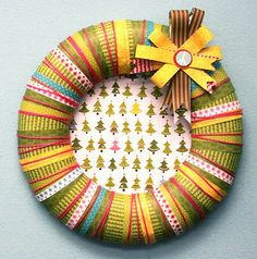 Cute wreath from Bella Blvd. Easy to do with strips of scrapbook paper, ribbons and yarn. Sweet.
