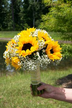 Beautiful round sunflower bouquet with babies breath and white monte flowers. Beautiful round sunflower bouquet with babies breath and white monte flowers. Prom Bouquet, Bride Bouquets, Prom Flowers, Bridal Flowers, Yellow Wedding, Dream Wedding, Wedding Bows, Wedding Ceremony, Wedding Dresses