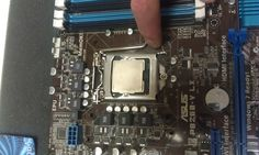 Intel Core i5-2500K Quad-Core Desktop Processor being installed in an ASUS P8Z68-V LX Motherboard