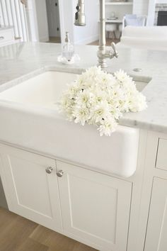 A classic white farmhouse sink from Kohler. Kohler products are available through Snow and Jones.