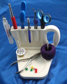 The GRABBIT tool. Made for jewelry makers but is useful for sewers as well. Purchased one from: http://www.tooltron.com/grabbit-jewelry-beading-tool-caddy/
