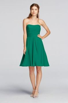 """Out for a night on the town or beside your favorite bride, this versatile dress can be worn at all types of occasions.  2"""" extra length dress.  Strapless pleated bodice with flowing crinkle chiffon skirt thatcreates an airy look.  Fully lined. Zipper Back. Imported polyester. Dry clean only.  Also available inMissy sizes as style F18028.  To protect your dress, try our Non Woven Garment Bag."""