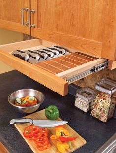 Under-cabinet knife block drawer - Away from the kids reach and off the counter! Smart idea!