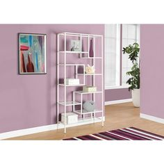 Give your home a bold, modern look with this unique 72-inch white metal and clear tempered glass bookcase. This chic, backless unit features 9 asymmetrical shelves in various sizes, perfect for displaying your favorite items.
