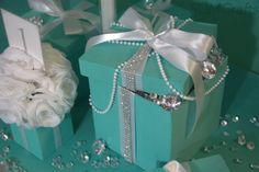 Want a bit more glam? Try these handmade bling gift boxes with ribbon. Featuring pearls and bling ribbon, these beauties may steal the spotlight. Leave them closed or fill them up with more blin Tiffany Blue Weddings, Tiffany Theme, Tiffany Wedding, Tiffany Centerpieces, Pearl Centerpiece, Candle Centerpieces, Wedding Centerpieces, Aqua Wedding, Wedding Table