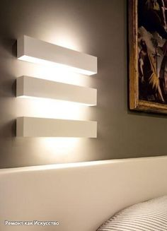 restaurant wall indoor wall lamp for direct or indirect lighting. made of polished stainless steel, white or grey painted metal or weathered brass
