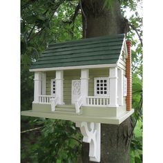 Four Pillars and intricately carved door and window details are some of the signature designs of this Arts & Crafts Birdhouse. A detailed chimney and a tasteful gray and green pine shingled roof give