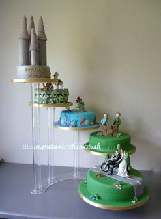 Five tier wedding cake.  Incorporating the Bride and Groom on a motorbike, their hobby of shooting.  Their love of Disney Little Mermaid, Tangled and the Castle turrets!  We enjoy a challenge and this certainly provided one during an extremely hot week in the UK.
